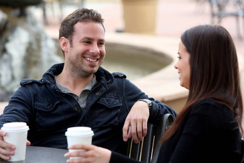 man and woman outside on coffe time