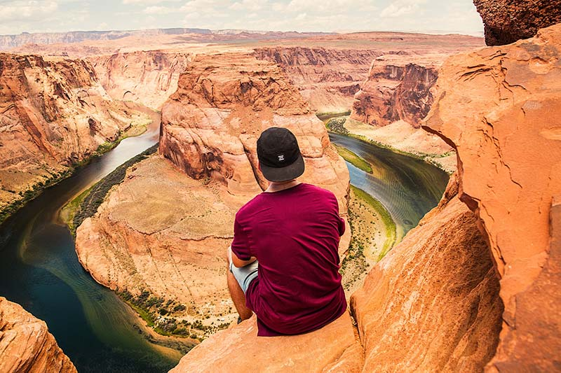 an sitting on mountain edge at grand canyon