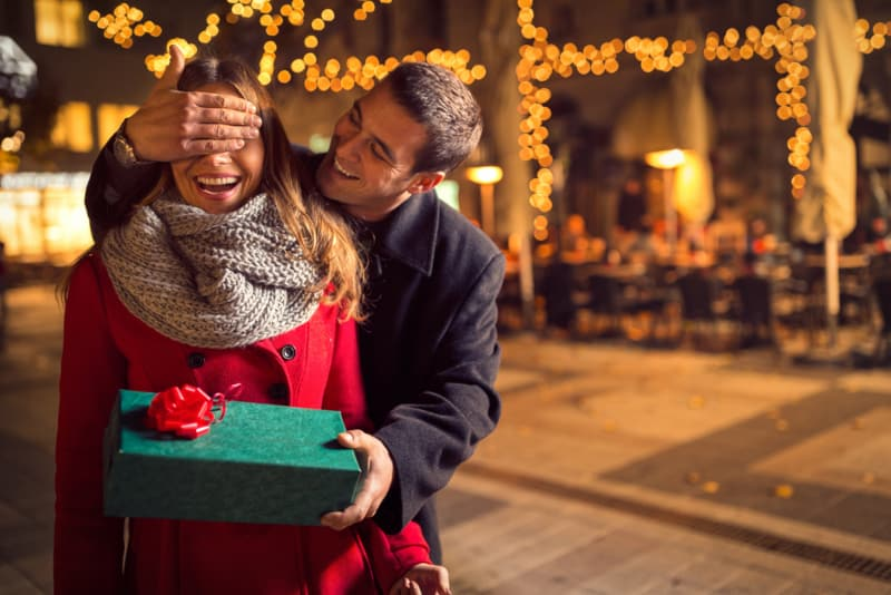 man giving gift to his girl