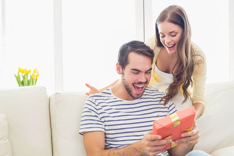 man thrilled by the gift from his girlfriend