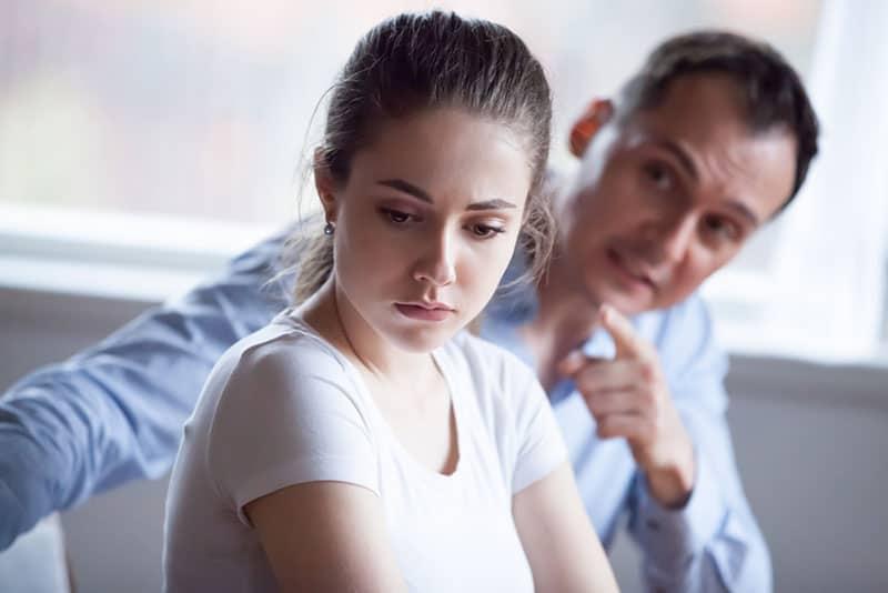 man yelling at sad woman