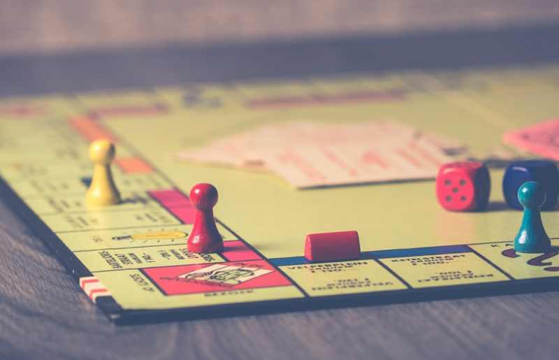 Monopoly board game on brown wooden tabletop