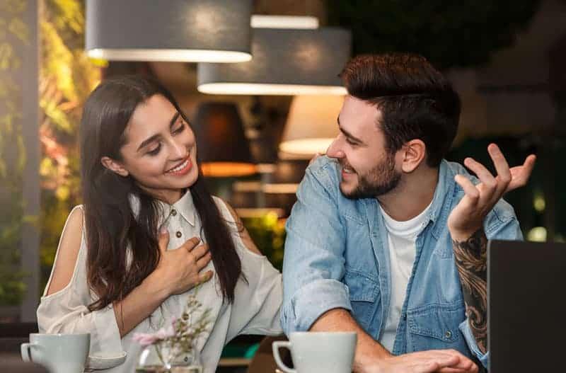 nice woman flirting with man