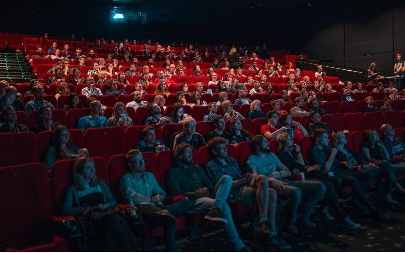 People in cinema room watching movie