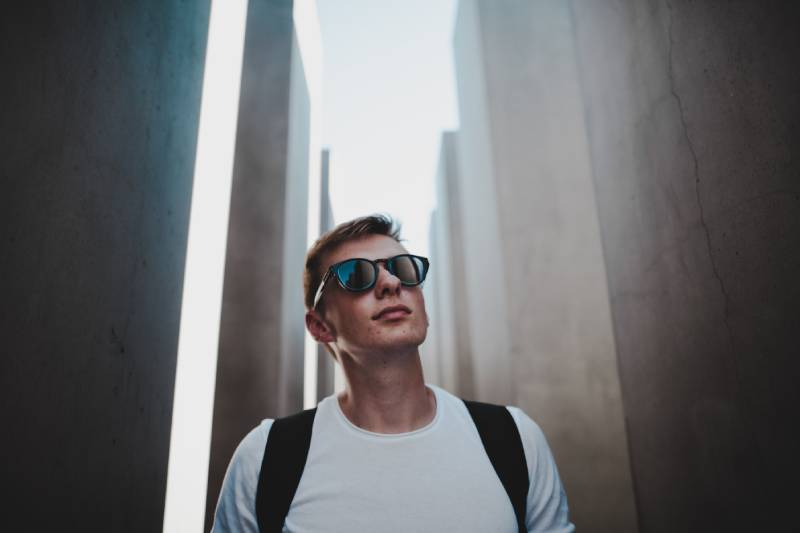 portrait of man in front of building
