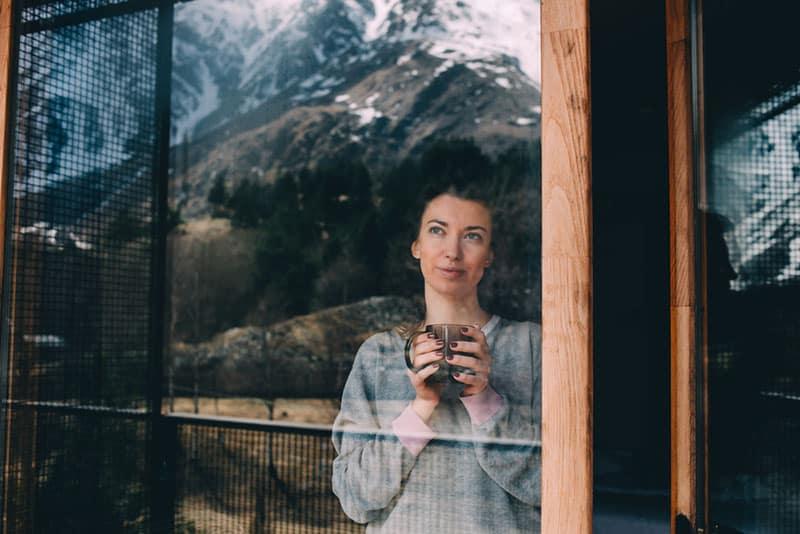 portrait of woman looking outside