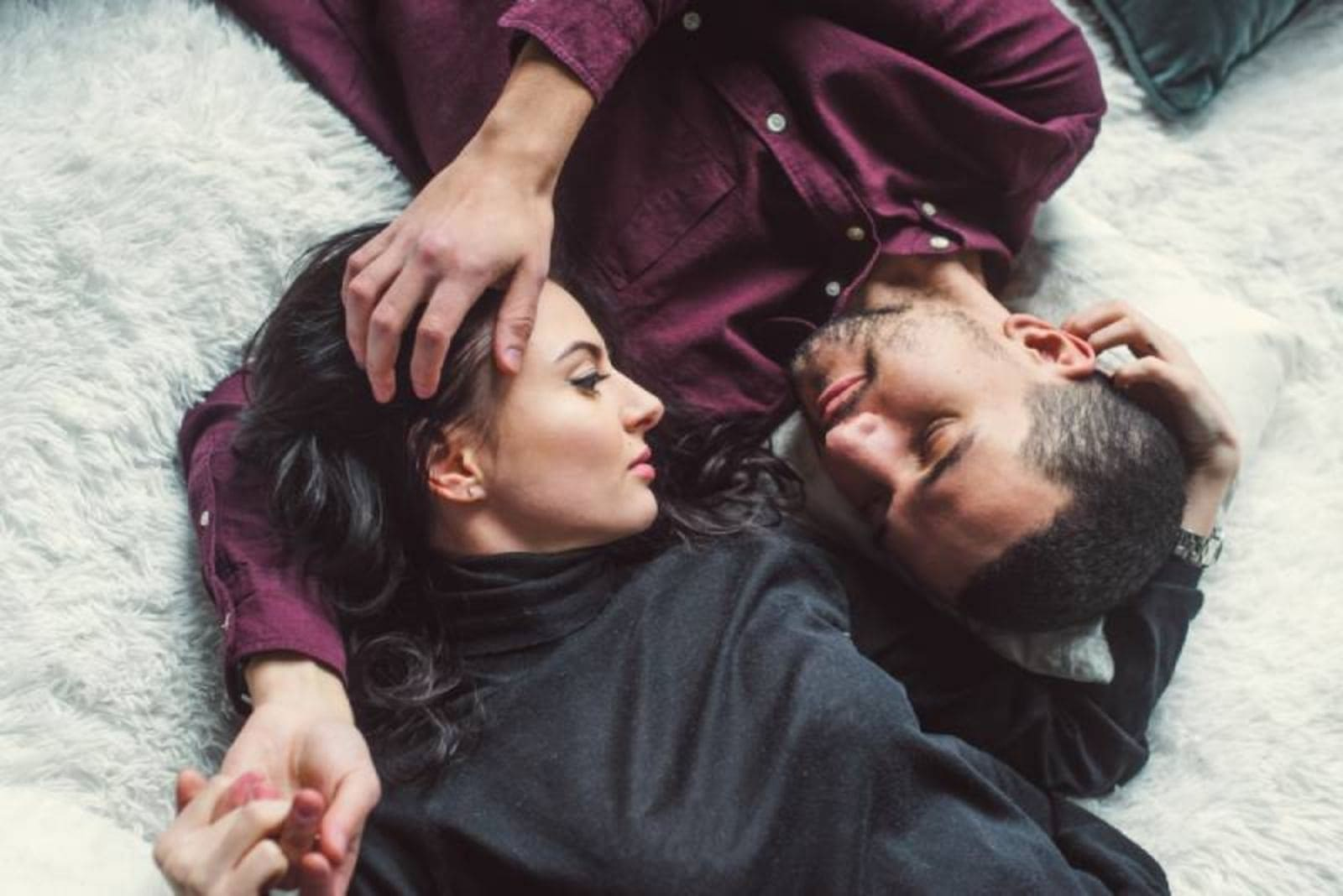 romantic couple lying on floor at home