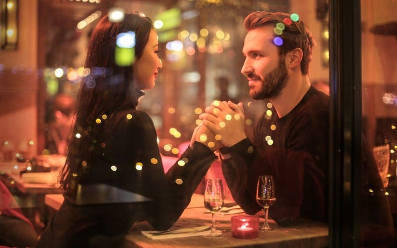 romantic couple sitting at restaurant