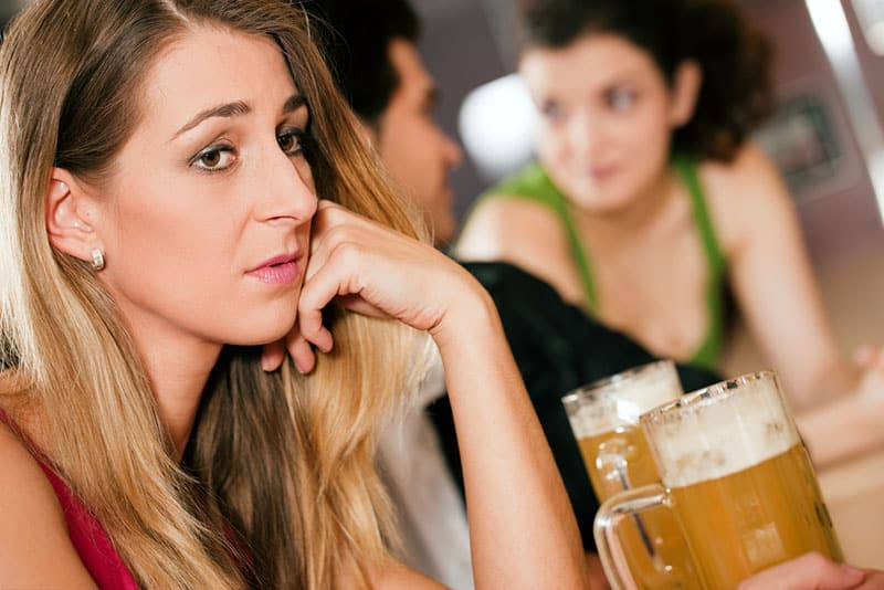 sad young woman in bar