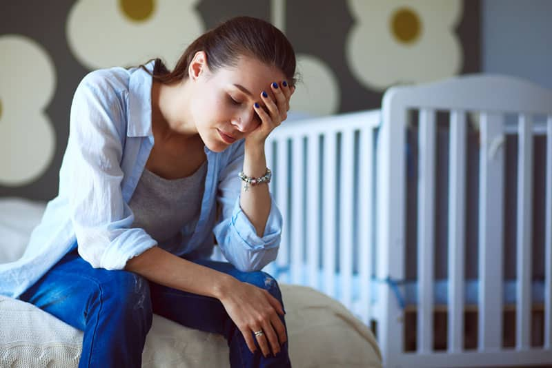 sad young woman in bedroom
