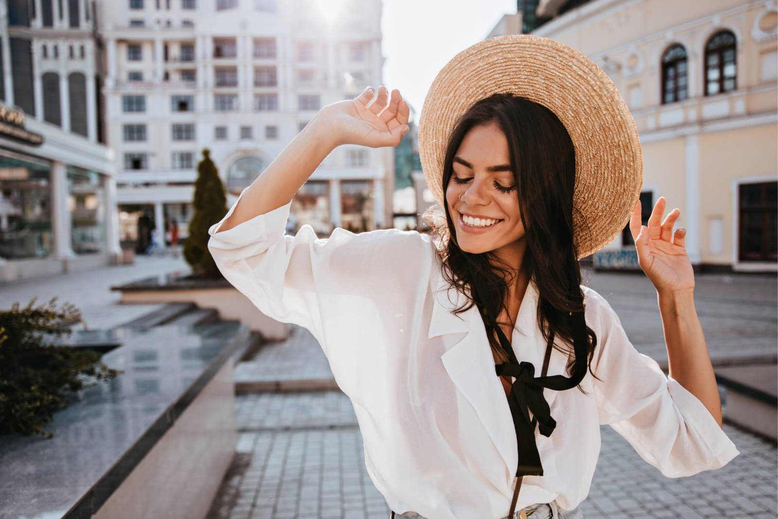 smiling woman outside wearing hat