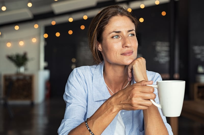 thoughtful woman in cafe