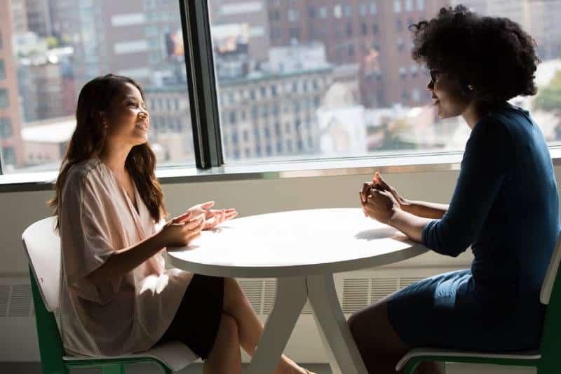two female friends talking