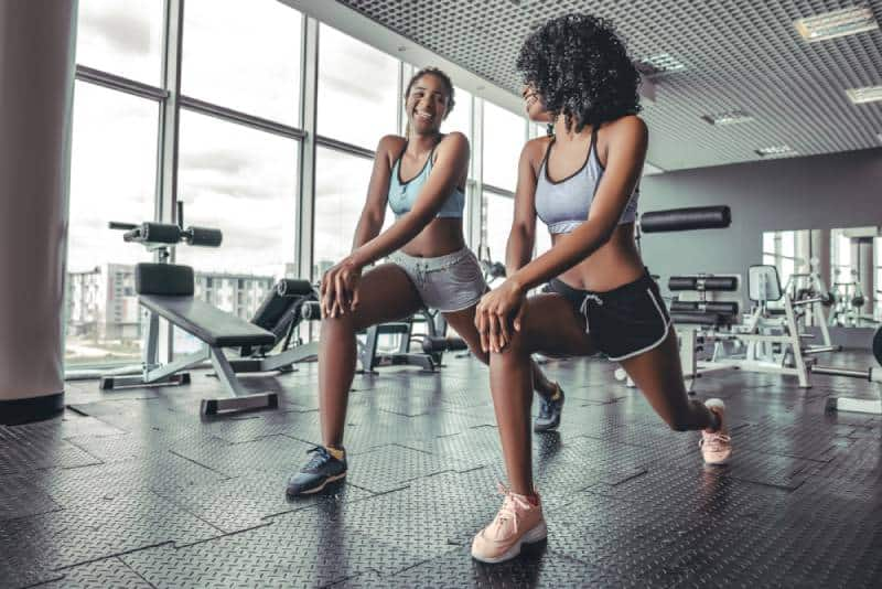 two girls working out at gym