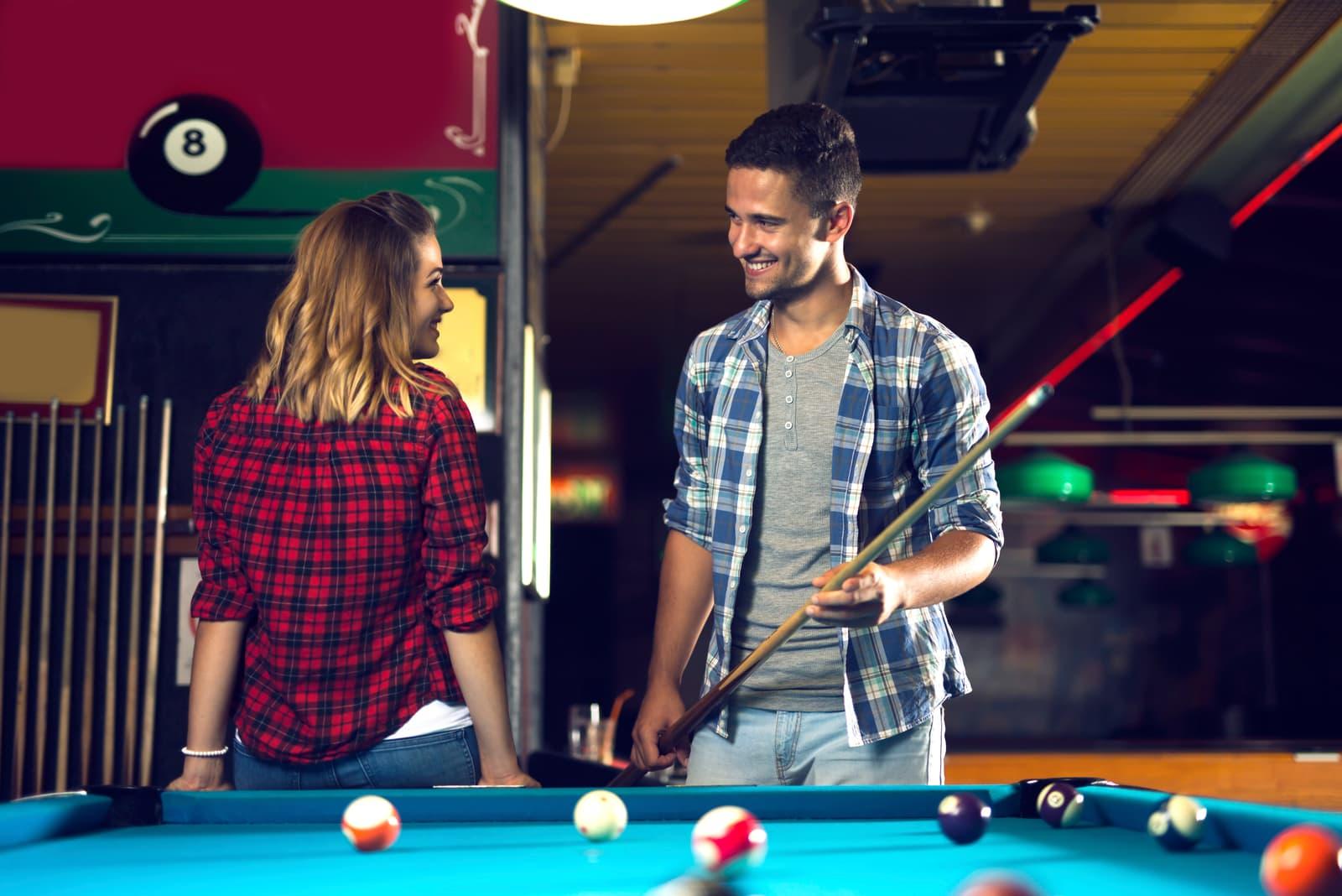 woman flirting with man in the billiar club