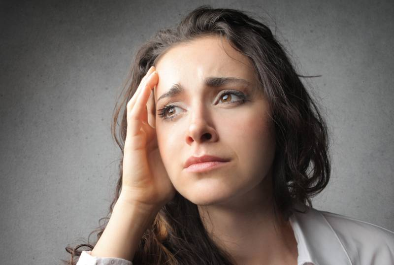 woman hold her head and crying
