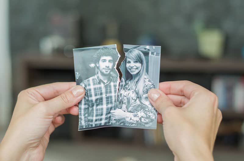 woman holding broken picture