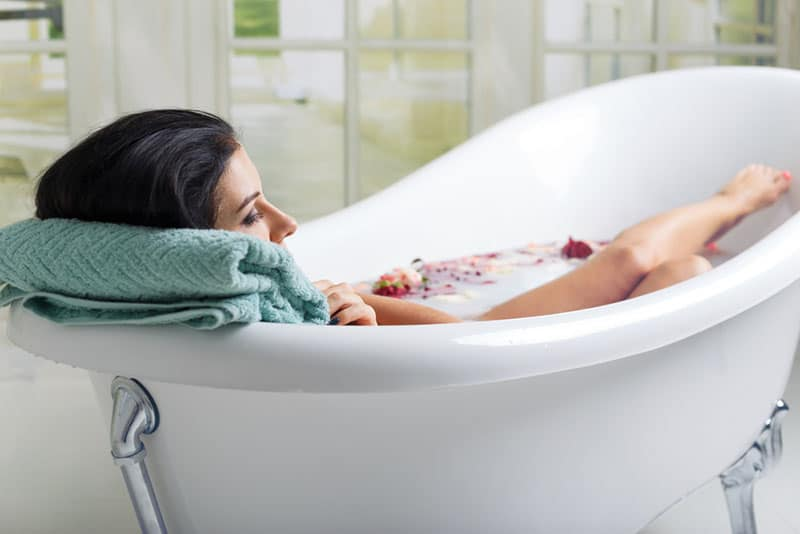 woman in bathtube thinking