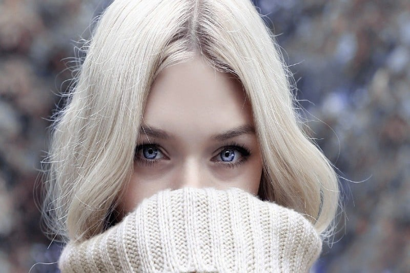 Blonde woman in white knit sweater