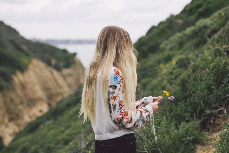 woman picking flowers in the nature