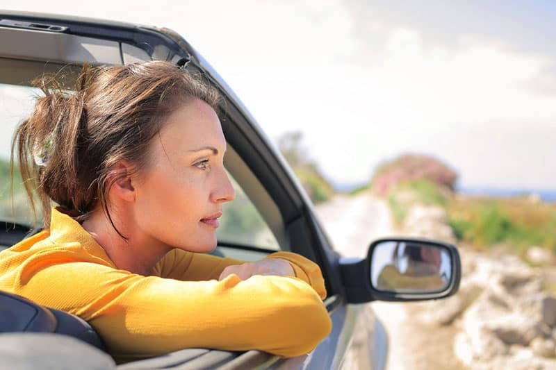 woman riding a car looking outside
