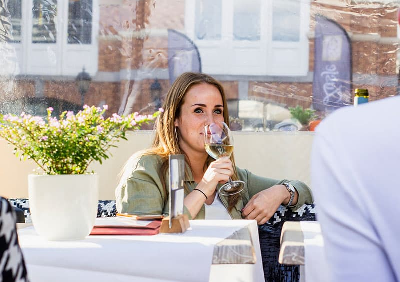 woman sipping wine while in a date