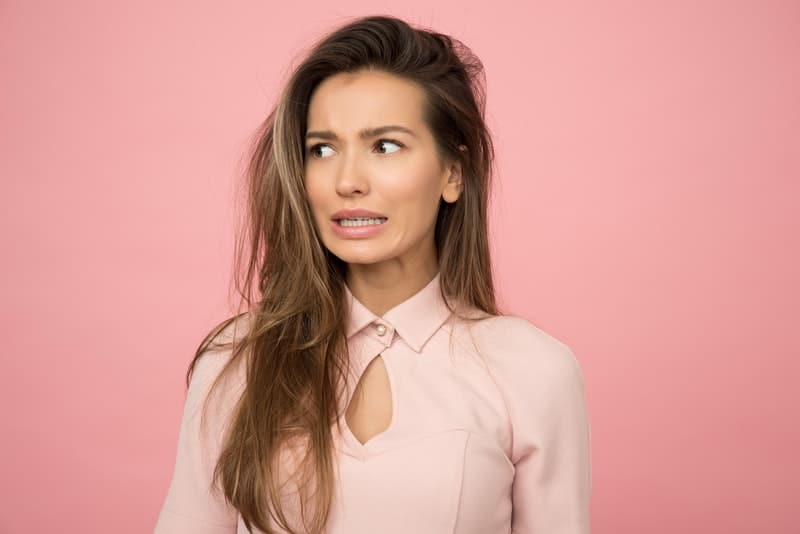 woman wearing pink with pink wall