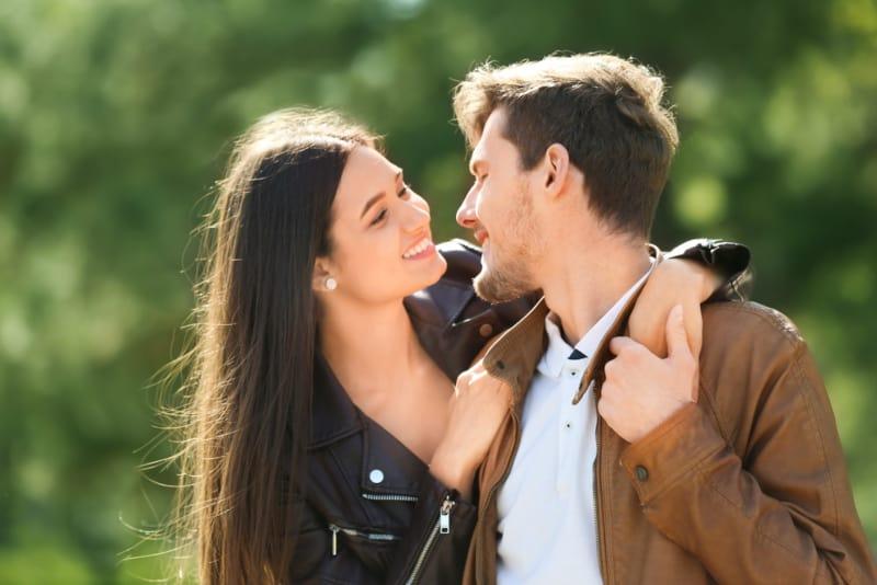 woman with long hair hugging man