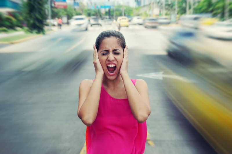 woman with panic attack in the middle of street