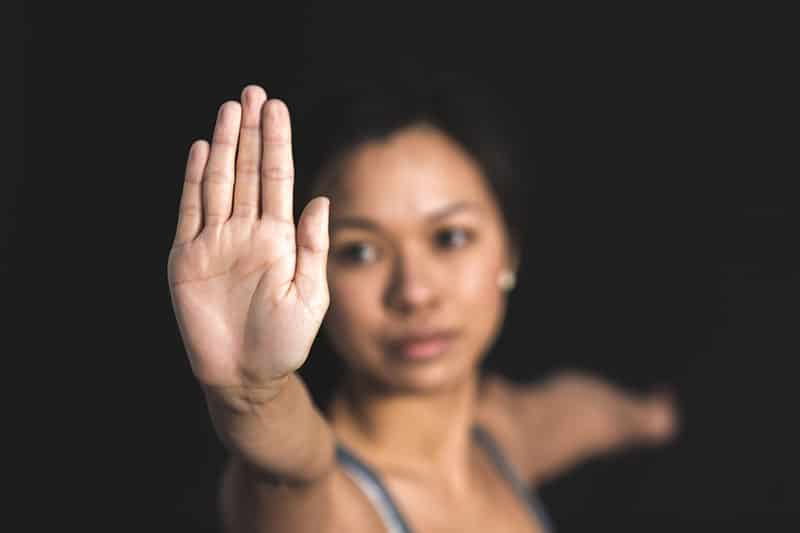 woman with stop sign focused on the right hand palm