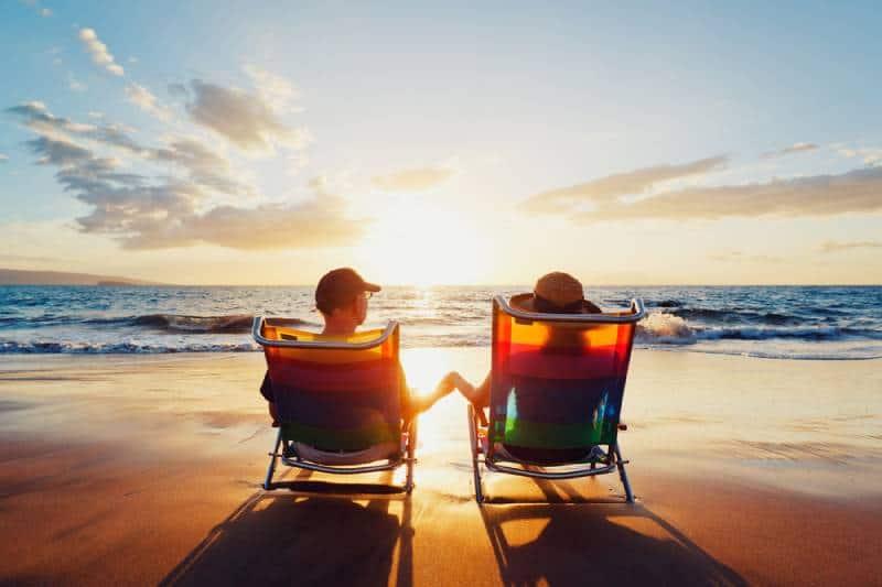 young couple enjoying susnset at beach