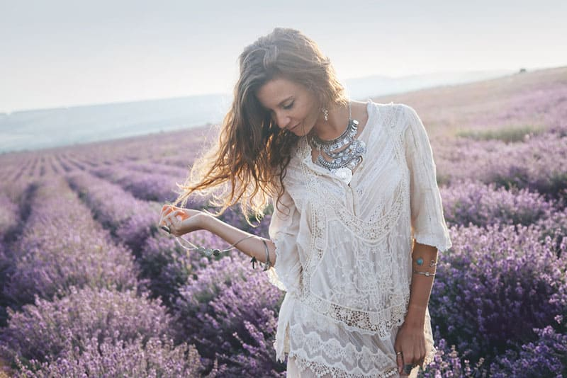 young woman standing in lavender field