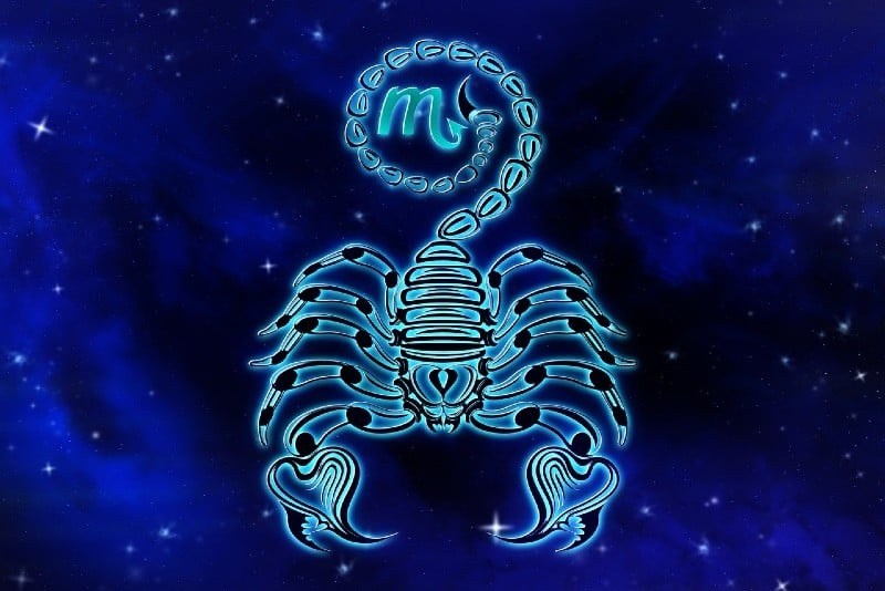 scorpio horoscope sign on blue background