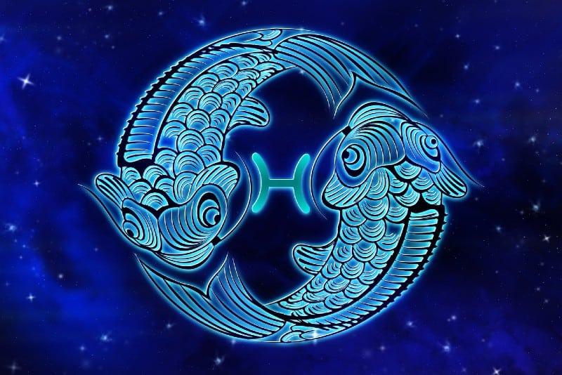 pisces horoscope sign on blue background