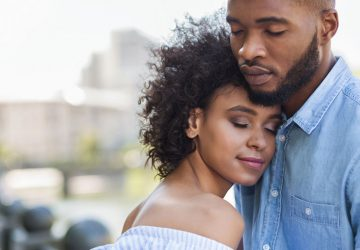 couple standing with closed eyes