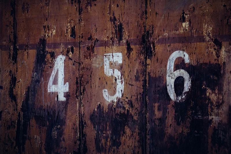 456 door number on brown background