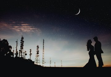man and woman standing under the star sky