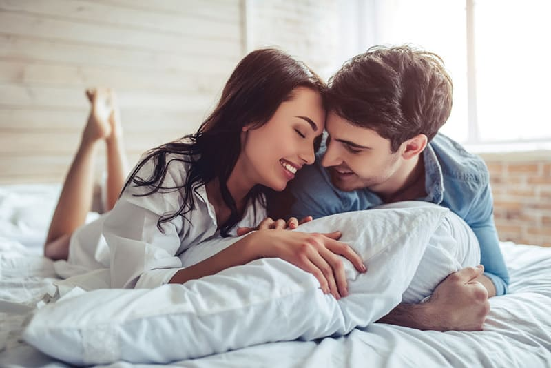 Beautiful couple enjoying the morning in bed