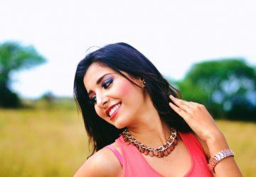 woman wearing pink sleeveless top an smiling