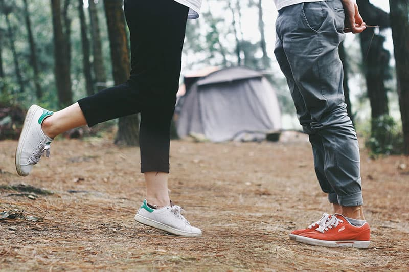 Close up of Couple's feet with sneakers on