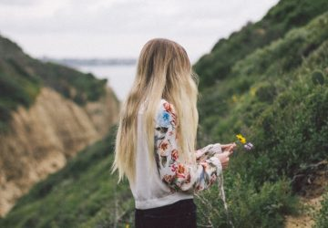 blonde woman picking flowers outdoor
