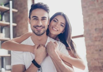 portrait of lovely couple smiling at home