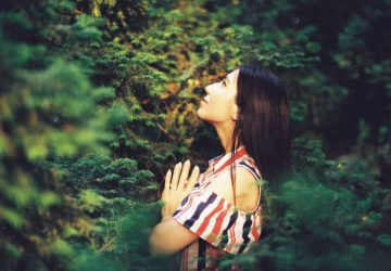 woman praying to god in nature