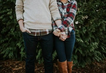couple holding their hands outside