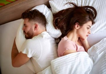 couple lying in bedroom opposite of each other