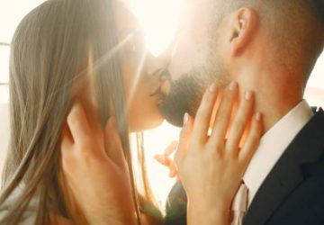 romantic couple kissing each other