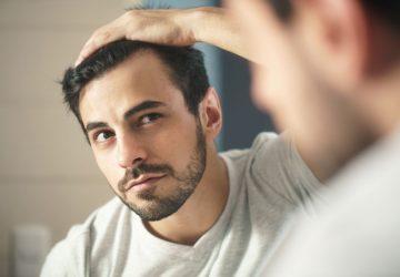 latino man looking at himself