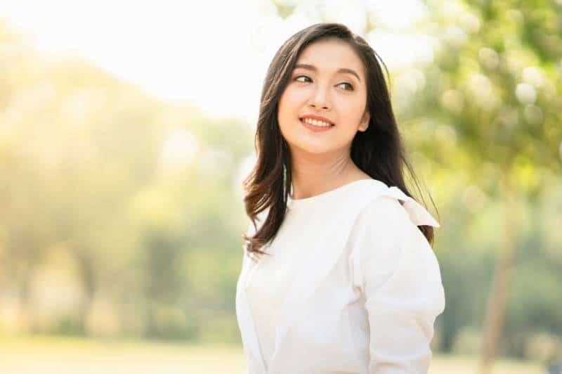 Woman wearing casual white shirt outdoors
