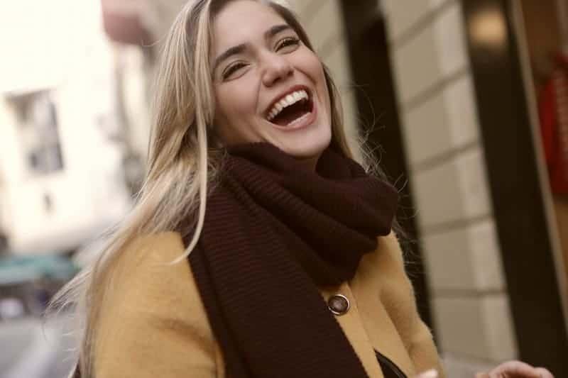 a joyous woman in coat