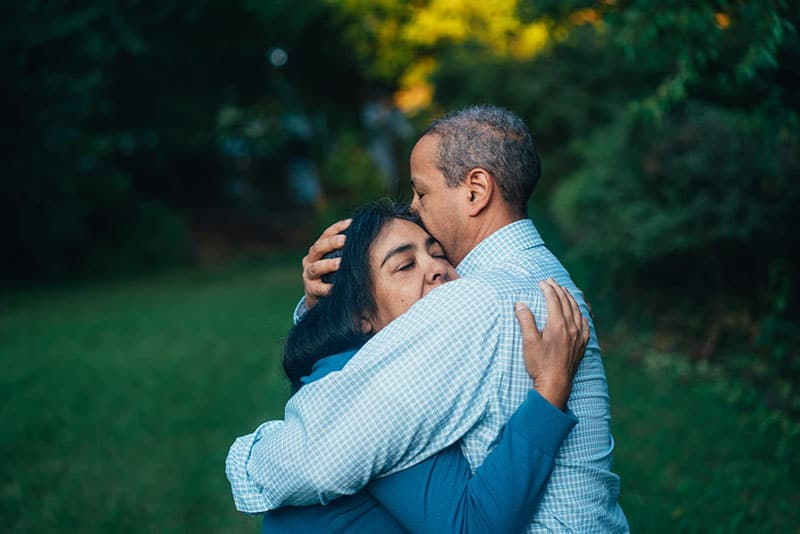 adult couple embracing in the garden